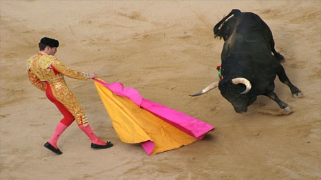 Spanish matador (not Joselito Ortega) waves his pink cape