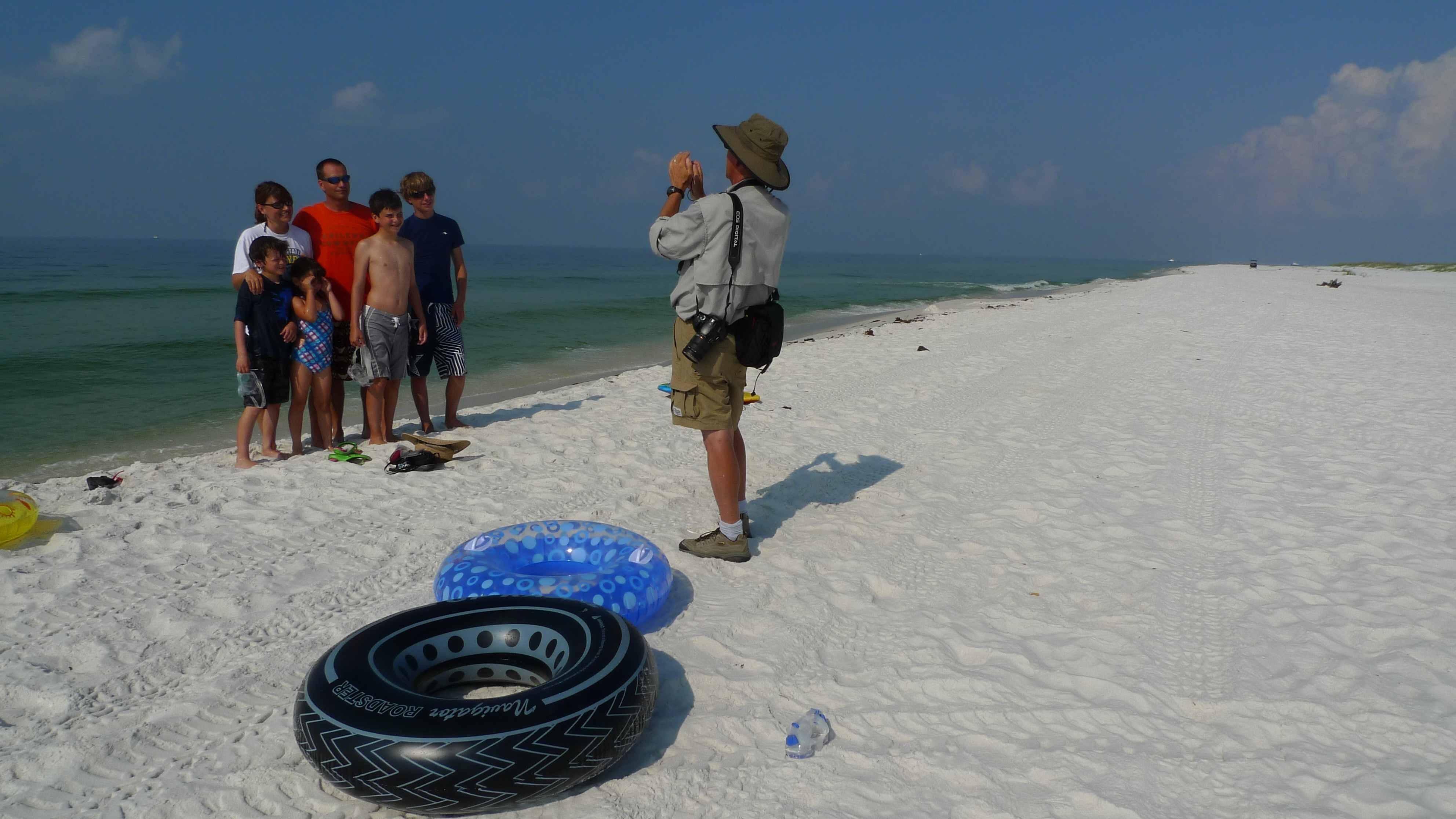 National Parks volunteer snaps a photo of a Kansan family at Gulf Shores National Seashore, near Pensacola, Florida.