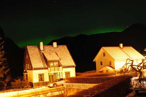 Northern Lights reflecting on houses