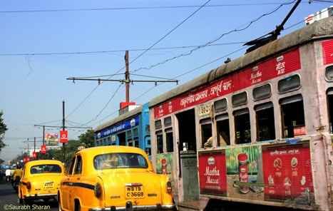Taxis and trams on a busy Calcutta road