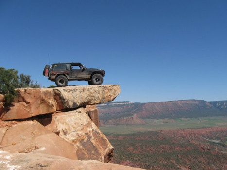 Car standing on a cliff