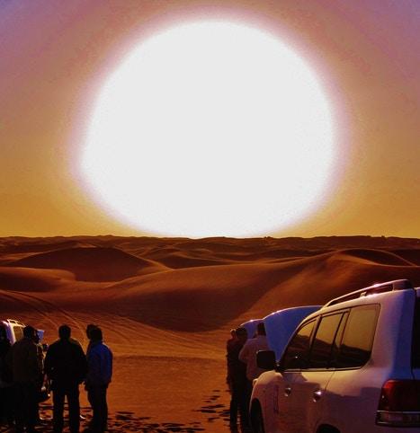 Sun setting on sand dunes