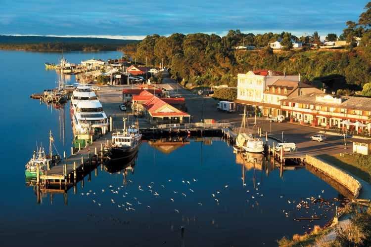 Strahan village and waterfront, Tasmania. Image c/o Tourism Tasmania & Dan Fellow.