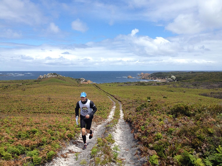 Uphill all the way... Team LP's David races through Strahan. Image by Georgie Leslie / Lonely Planet.