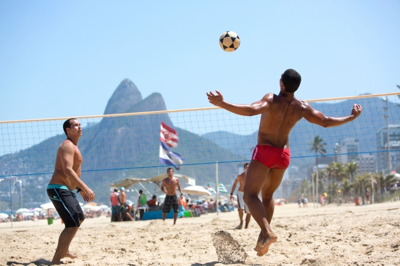 Men playing foot volley on Ipanema Beach.