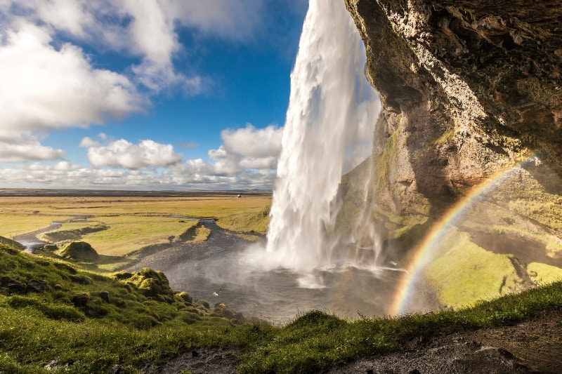 Cascading water creates a rainbow at Seljalandsfoss, Iceland. Image by Gary Latham / Lonely Planet Traveller Magazine