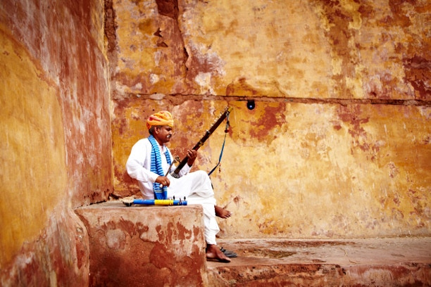 Musician playing a traditional instrument in Jaipur, India. Image by Matt Munro / Lonely Planet Traveller Magazine