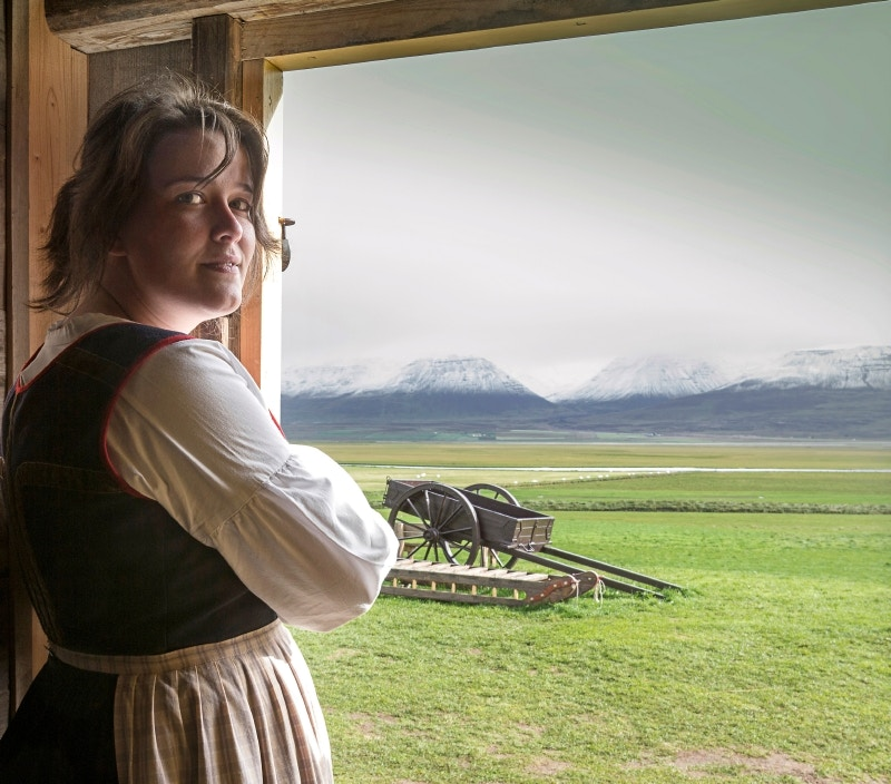 Portrait of local guide in traditional costume at Glaumbær Turf House Museum.