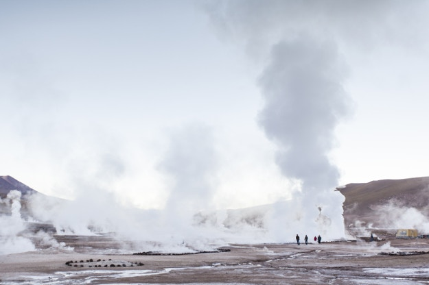 A group exploring the geysers at El Tatio © Joao Inacio / Moment Open / Getty