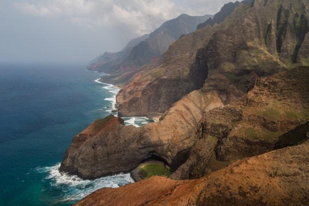 Natural arch on the south side of Honopu Beach on Na Pali Coast of Kauai.