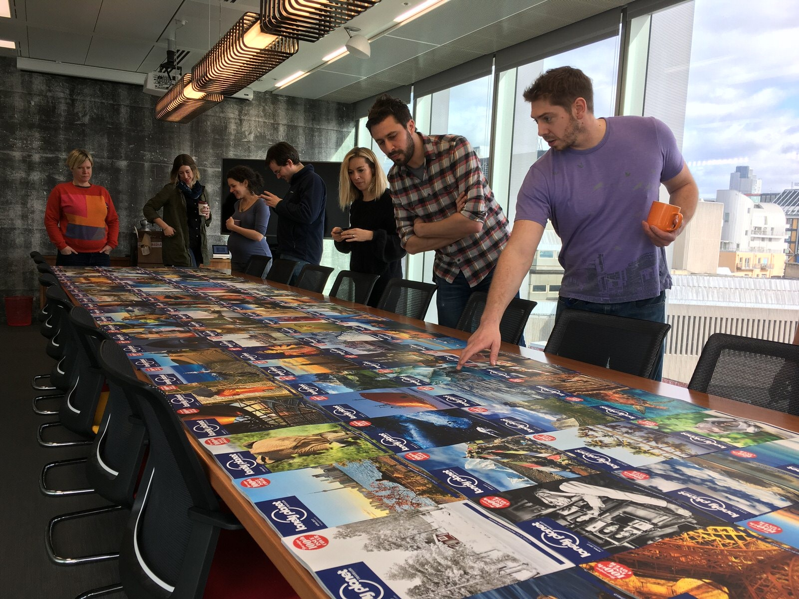 The UK magazine team view the 100th issue cover competition winners