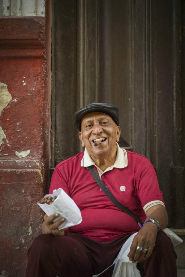 A man smokes a cigar in Havana, Cuba