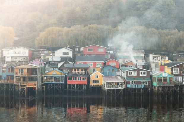 Woden stilt houses on the outskirts of Castro, Chiloé, Chile © Philip Lee Harvey / Lonely Planet
