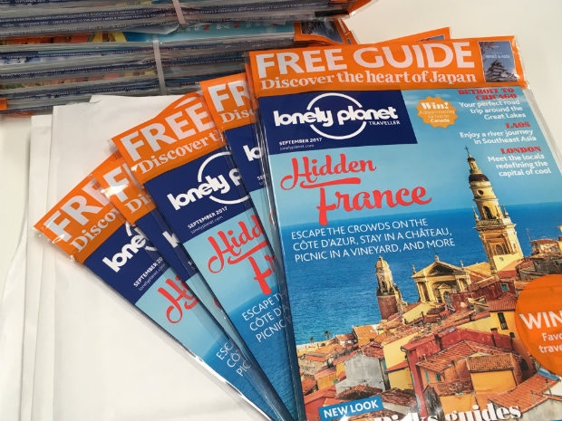 A pile of Lonely Planet Traveller magazines