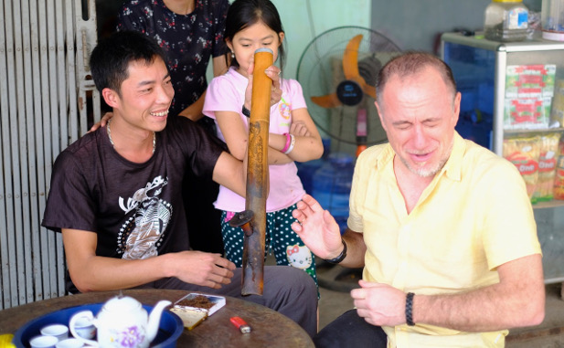 Trying a smoking pipe in Northern Vietnam
