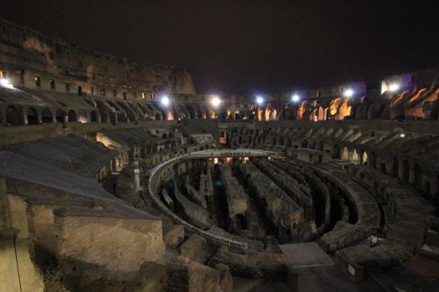 Inside Rome's Colloseum at night