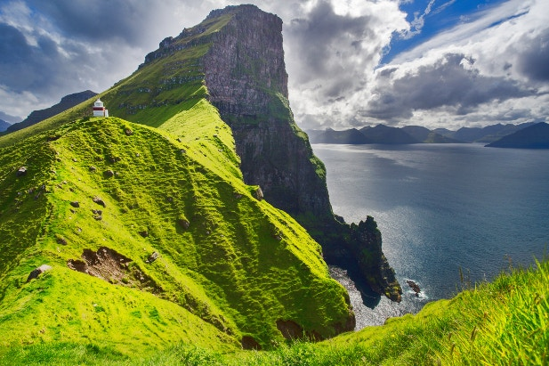 The Kallur Lighthouse perched on the peaks of the Faroe Islands