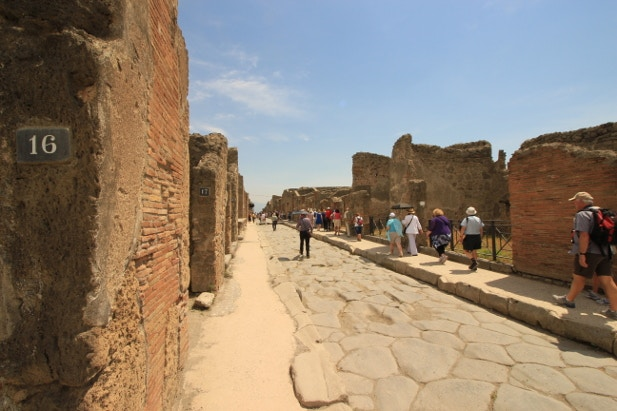 Tourists wandering the ruins of Pompeii