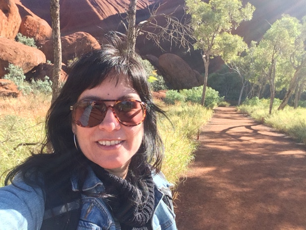 Tasmin on her self-guided stroll around the base of Uluru