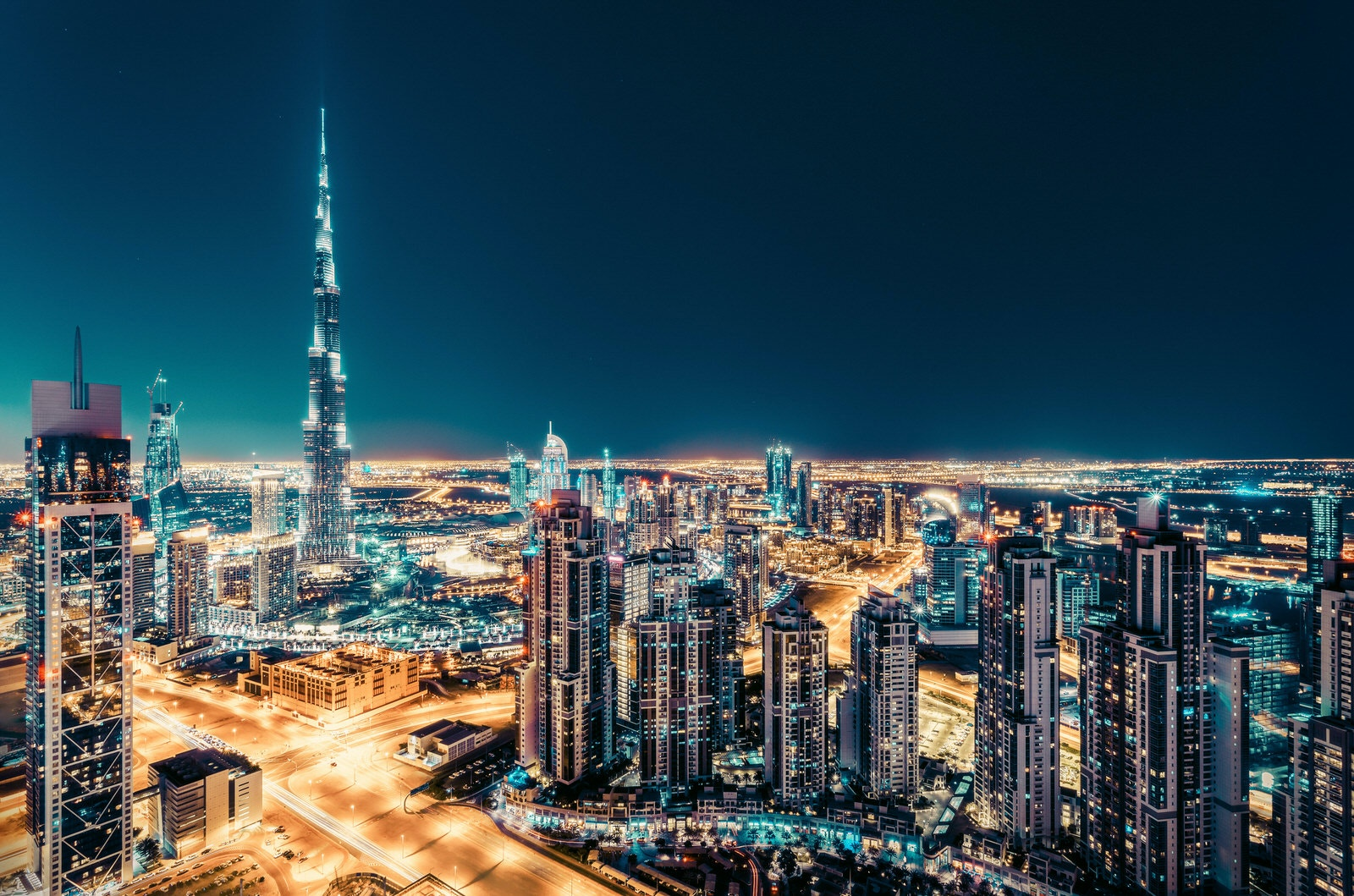 Elevated view of downtown Dubai, UAE, at night with illuminated skyscrapers © Funny Solution Studio / Shutterstock