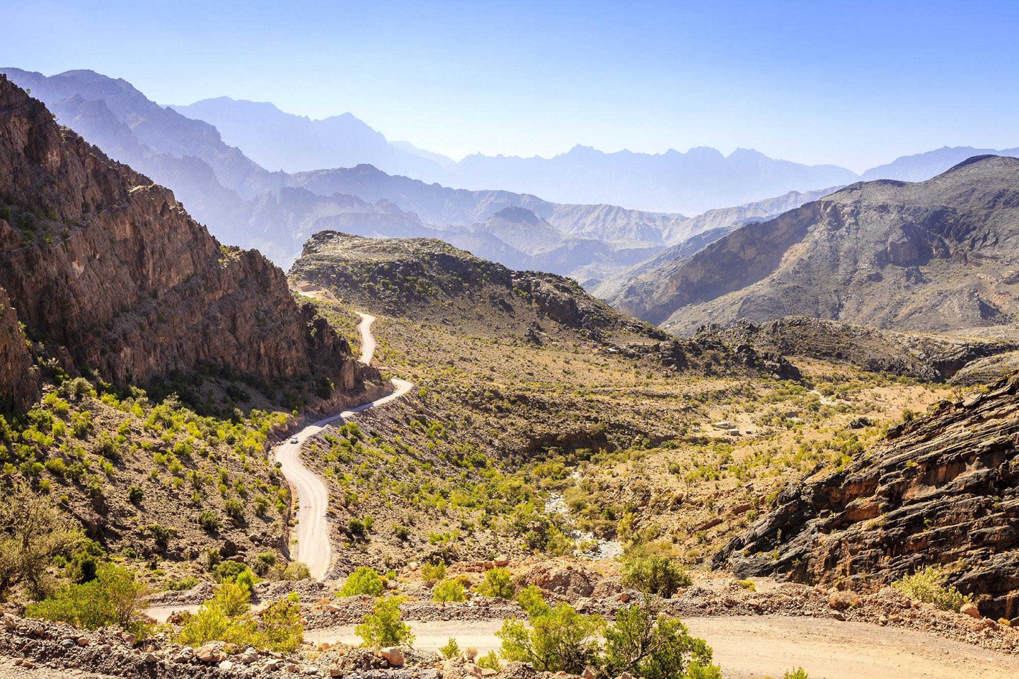 A road leading through Oman's Hajar Mountains © Alexey Stiop / Shutterstock