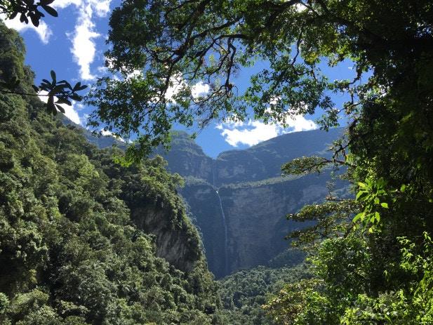 The Gocta Waterfall spotted through the dense Peruvian rainforest