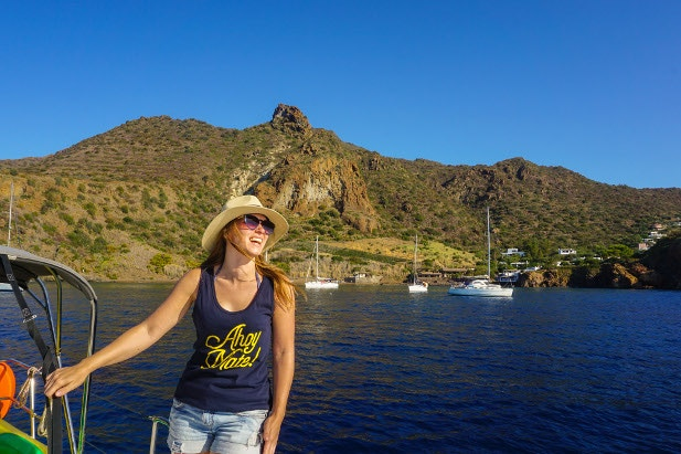 Chloe on a sail boat cruising around Sicily's Aeolian Islands