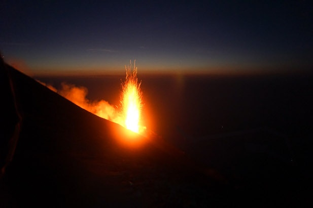 A burst of lava from Stromboli illuminates the night sky
