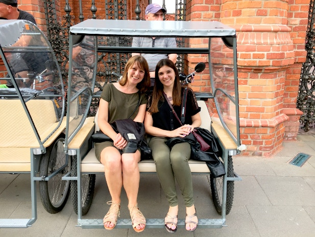 Claire and friend sitting in a pedicab before the start of their tour