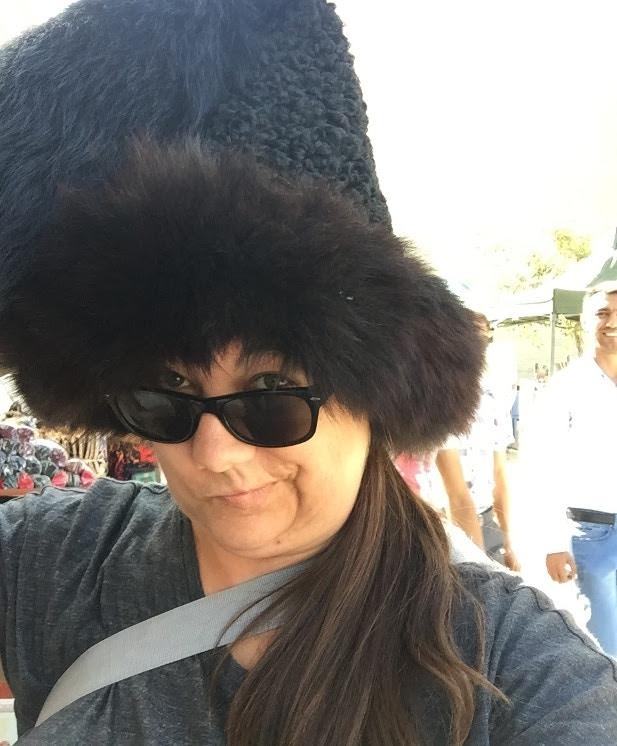 Megan wearing a traditional Turkmen hat