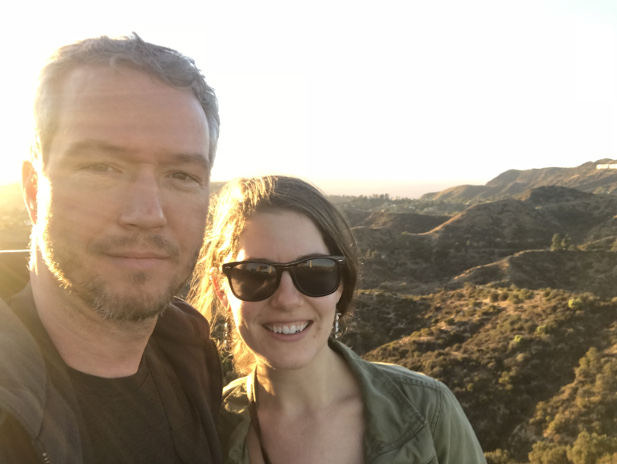Hannah and husband Matt attempting to take a selfie with the Hollywood sign which is just in the shot on the far right