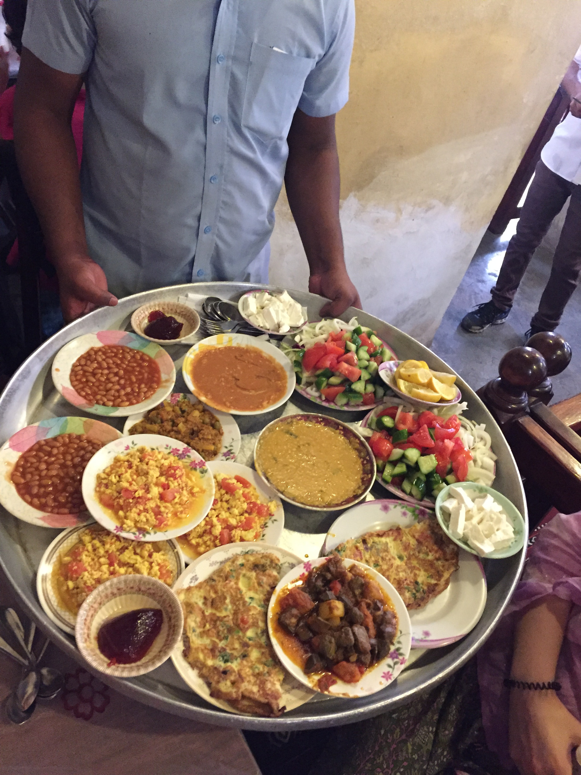 A huge tray of colourful breakfast dishes at Haji Gahwa restaurant