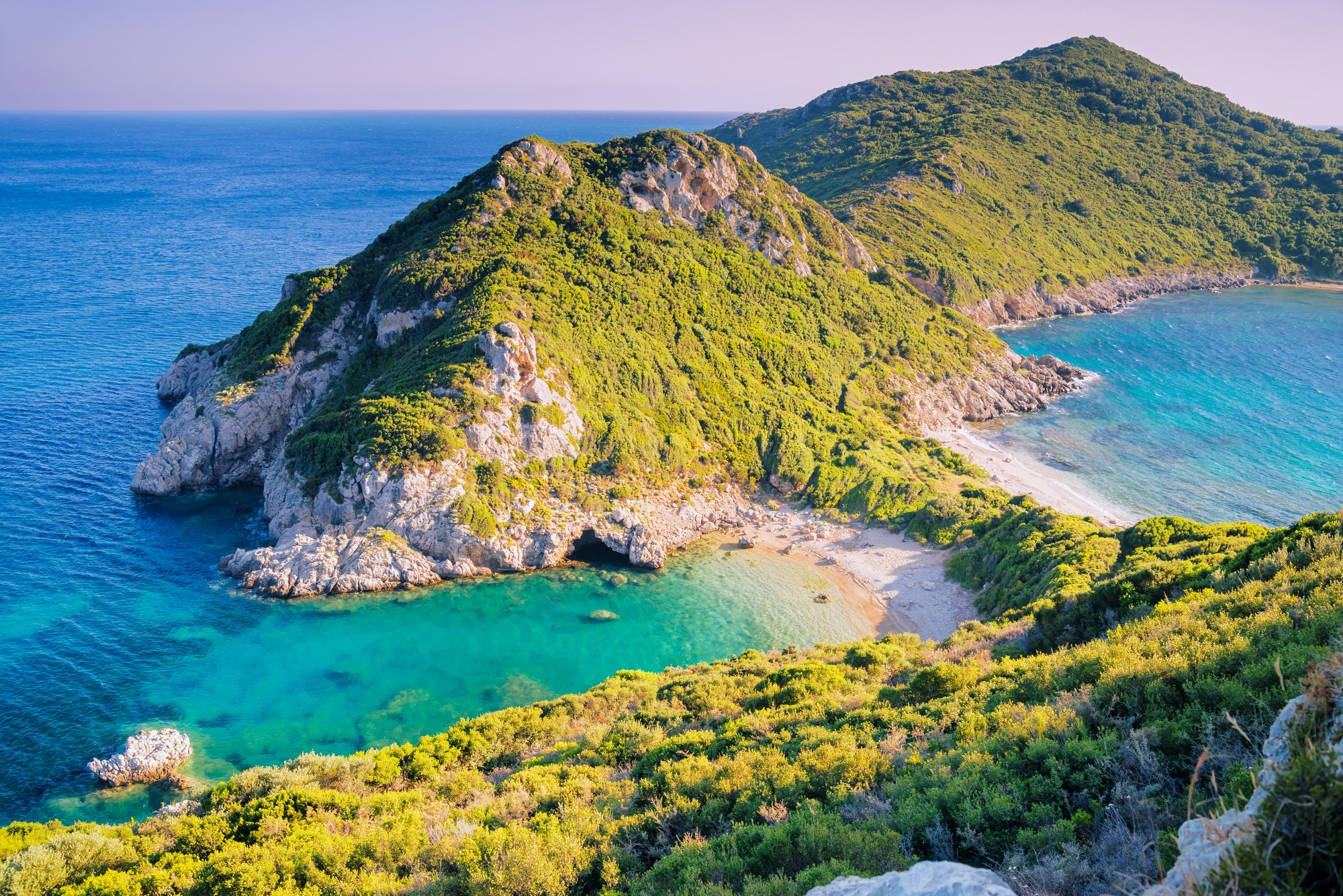 Agios Georgios beach in sunset, Corfu island, Greece © Elena Pavlovich / Shutterstock