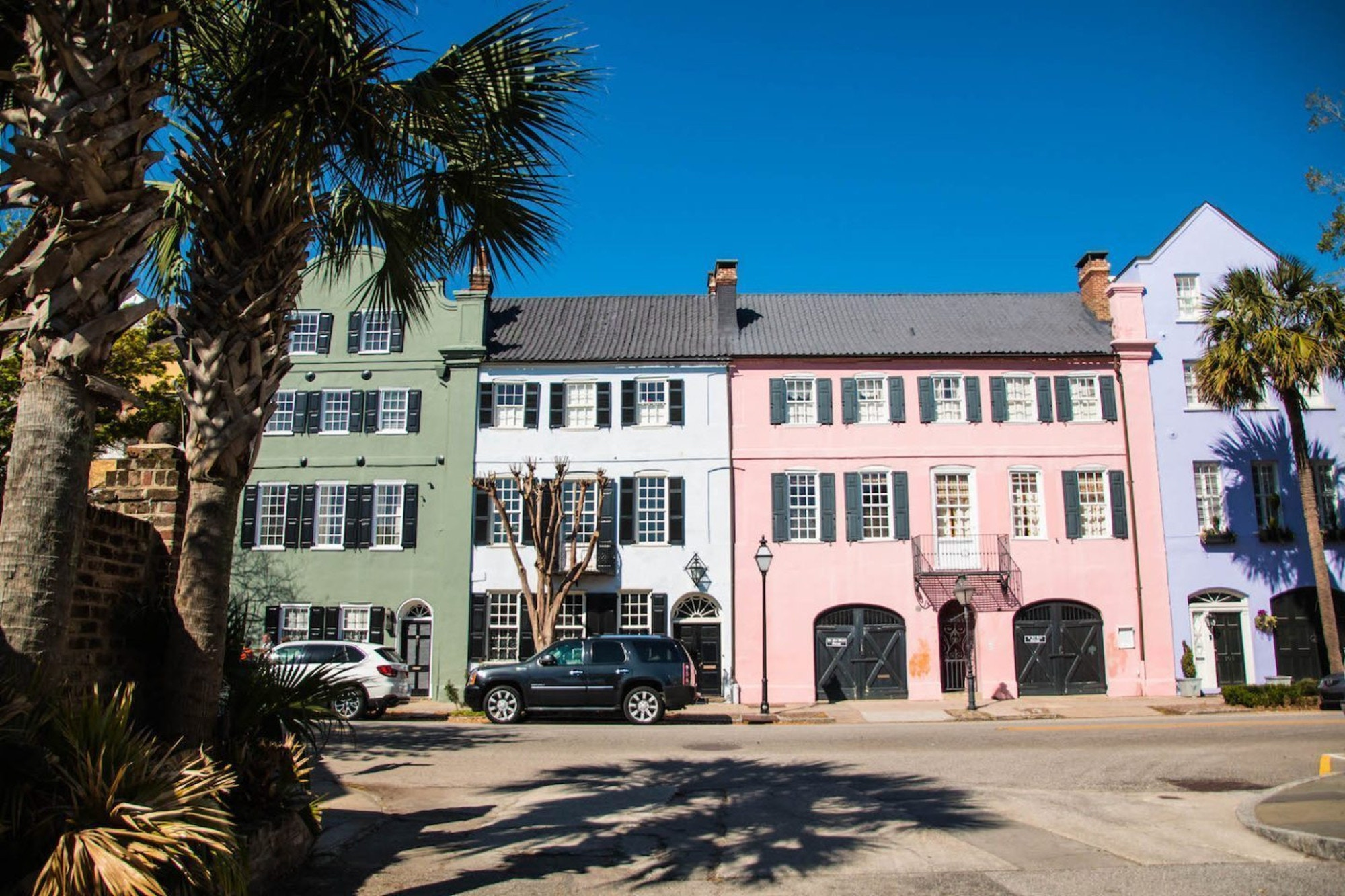 Exploring the colourful houses of Charleston's Rainbow Road © Holly Habeck
