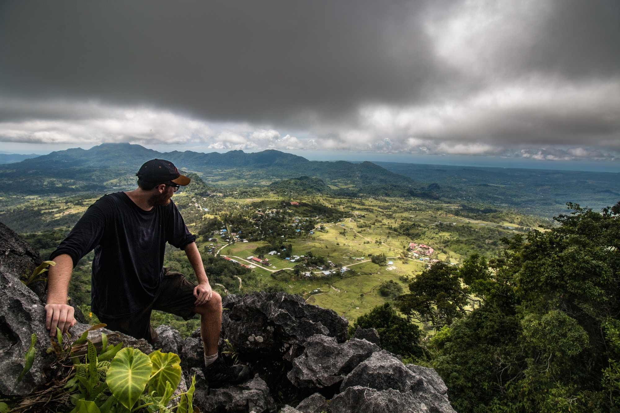 Looking out over the landscape from a mountaintop in East Timor © Richard Collett