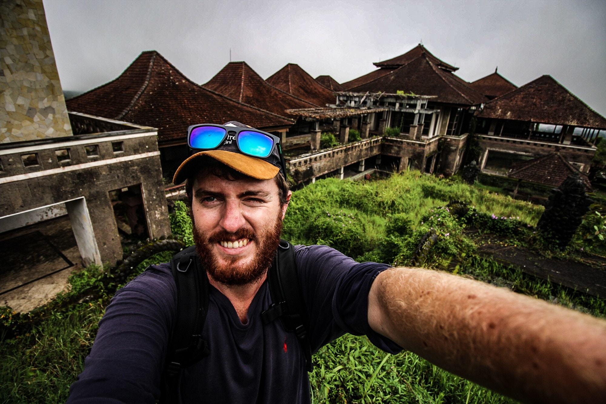 Richard exploring an abandoned hotel in Bali © Richard Collett