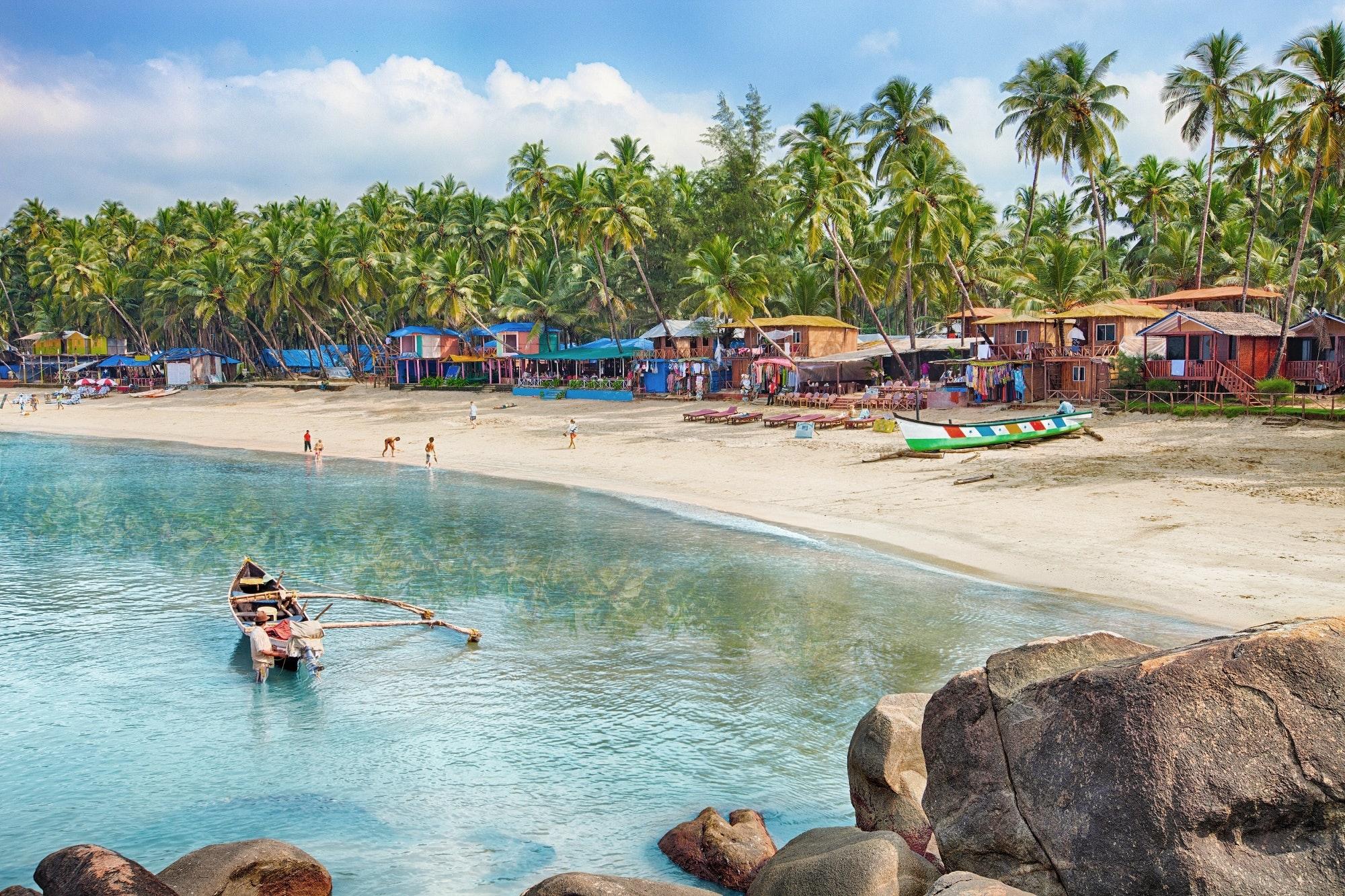 Palm-lined Palolem Beach in southern Goa © Lena Serditova / Shutterstock