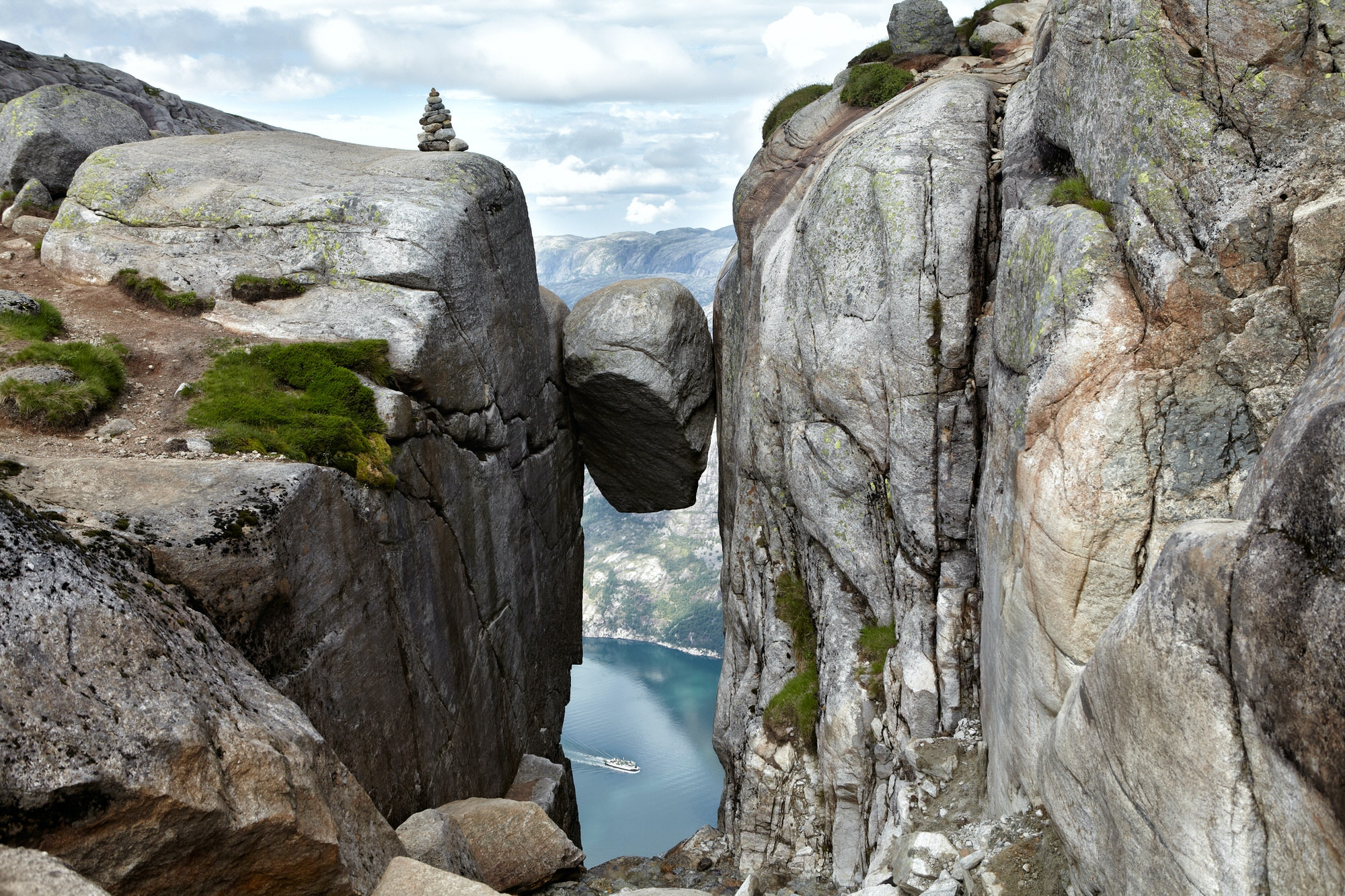 Norway's Kjeragbolten, a boulder precariously wedged in a mountain crevasse, has become a major tourist attraction for daredevils © Beas777 / Shutterstock
