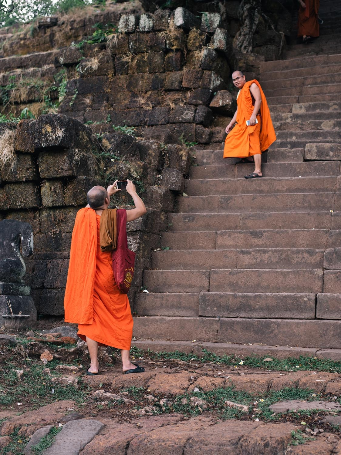 Monks enjoying a visit to Vat Phou, Laos © The World Ahead of Us
