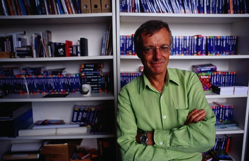 Tony Wheeler in a library of Lonely Planet guides © Lonely Planet