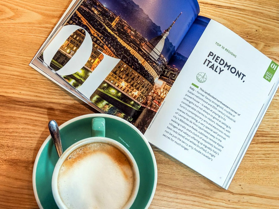 Lonely Planet's Best in Travel 2019 book alongside a cup of coffee
