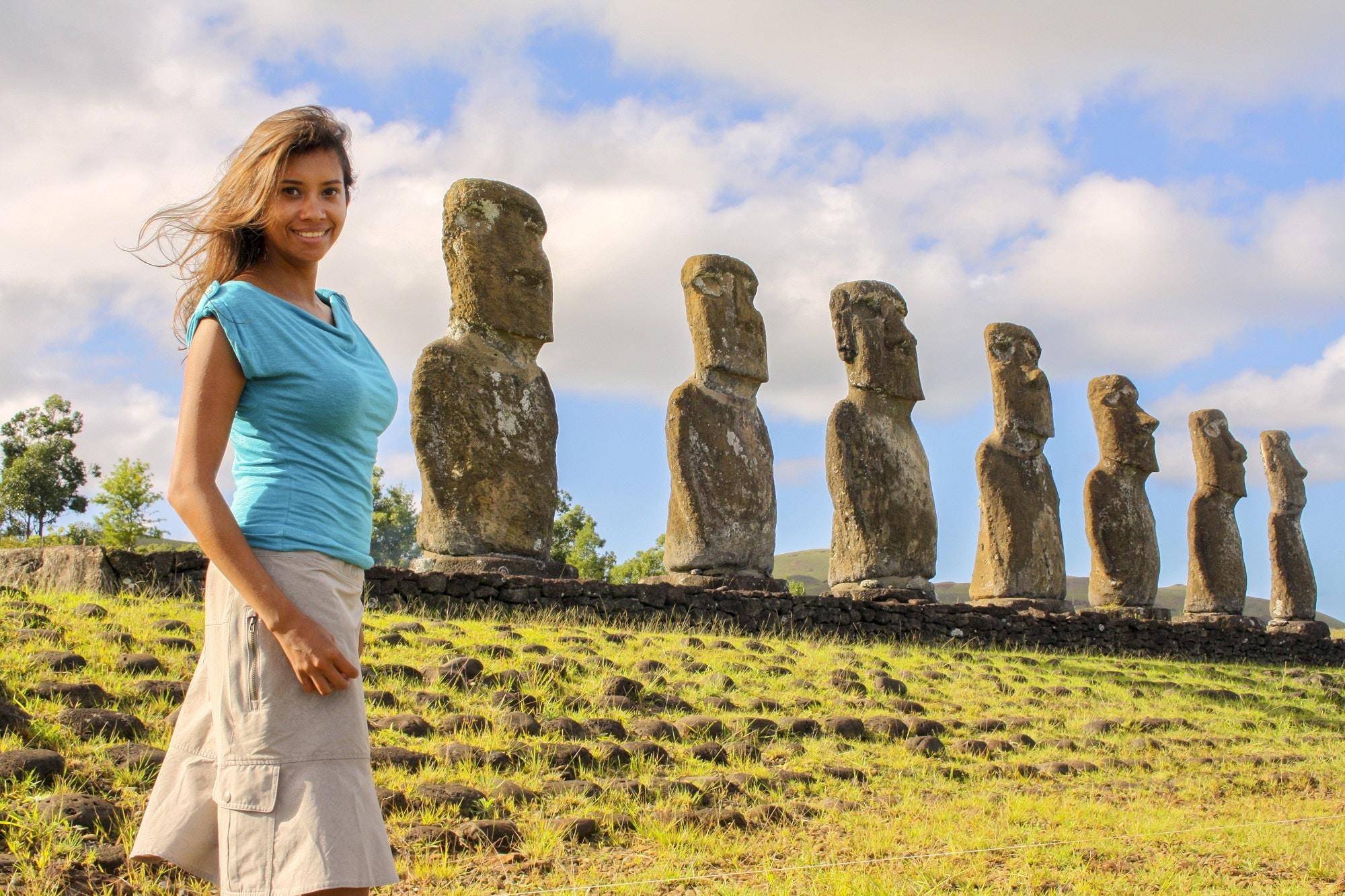 Kia Abdullah posing with the moai on Easter Island