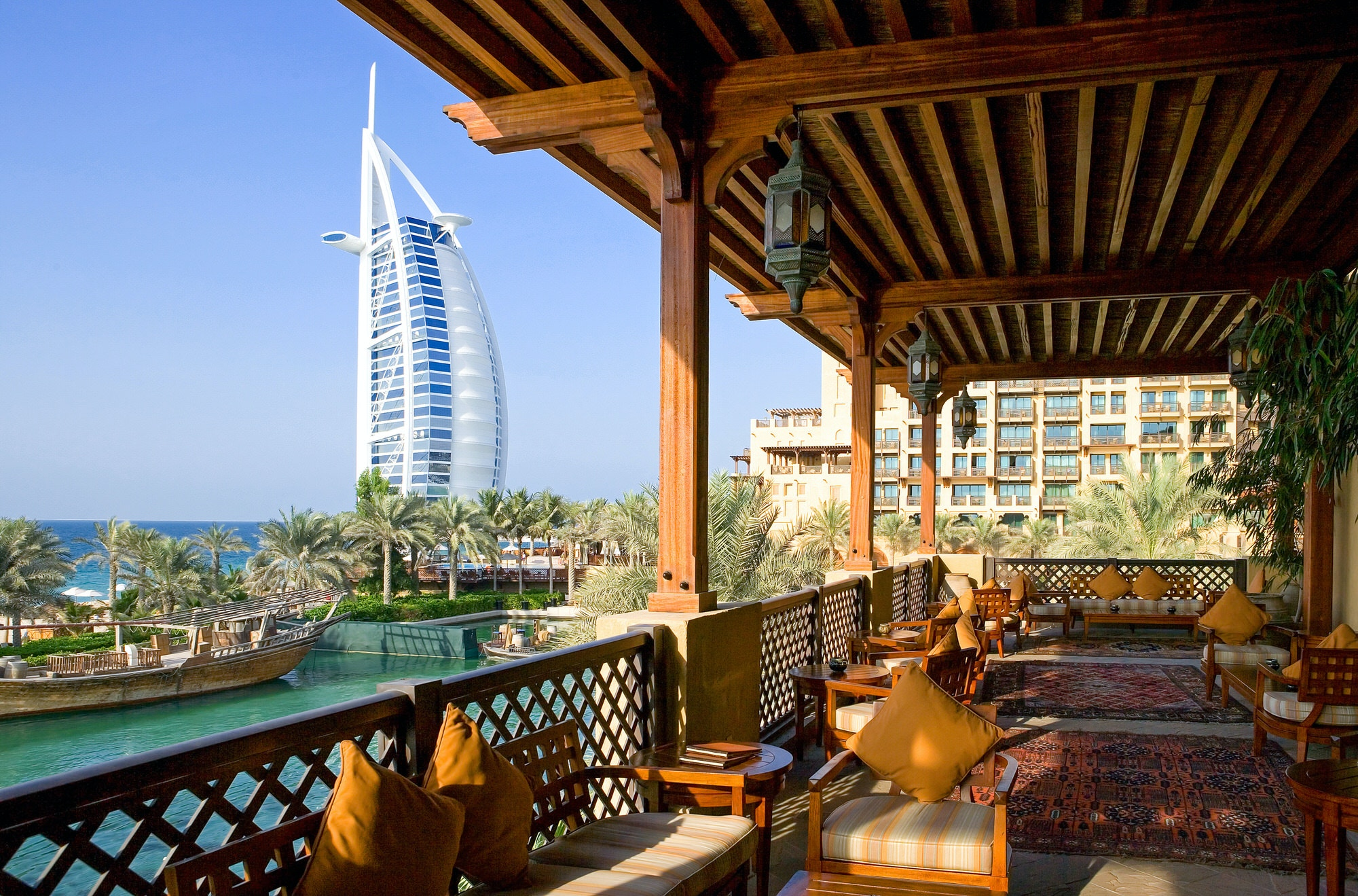 The open-air restaurant of the Madinat Jumeirah resort, in the background the Burj al Arab tower