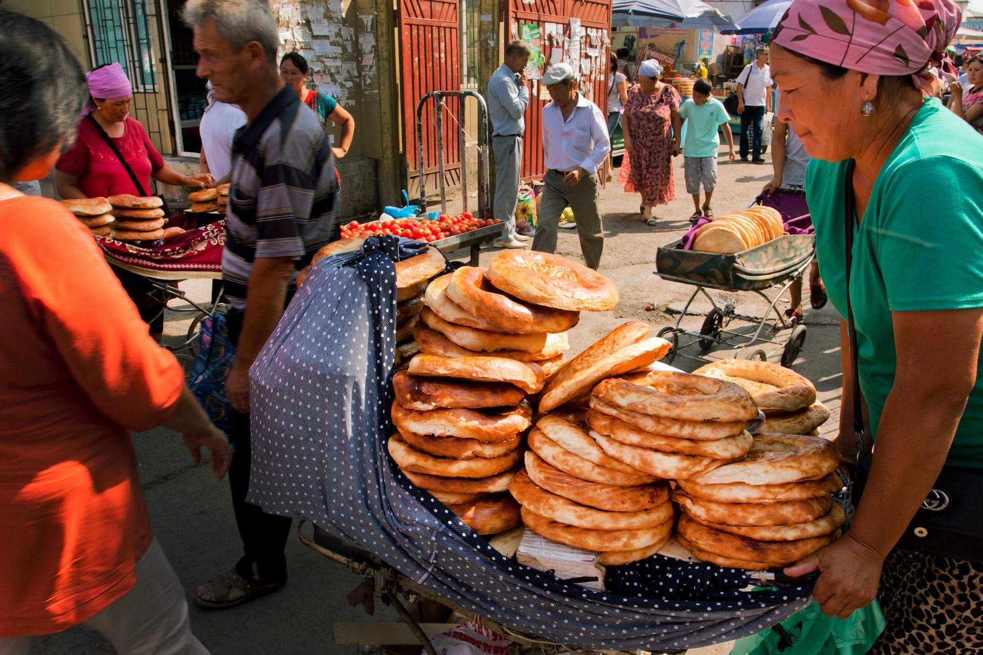 Women selling traditional Central Asian bread at popular Osh market bazaar in Bishkek, Kyrgyzstan