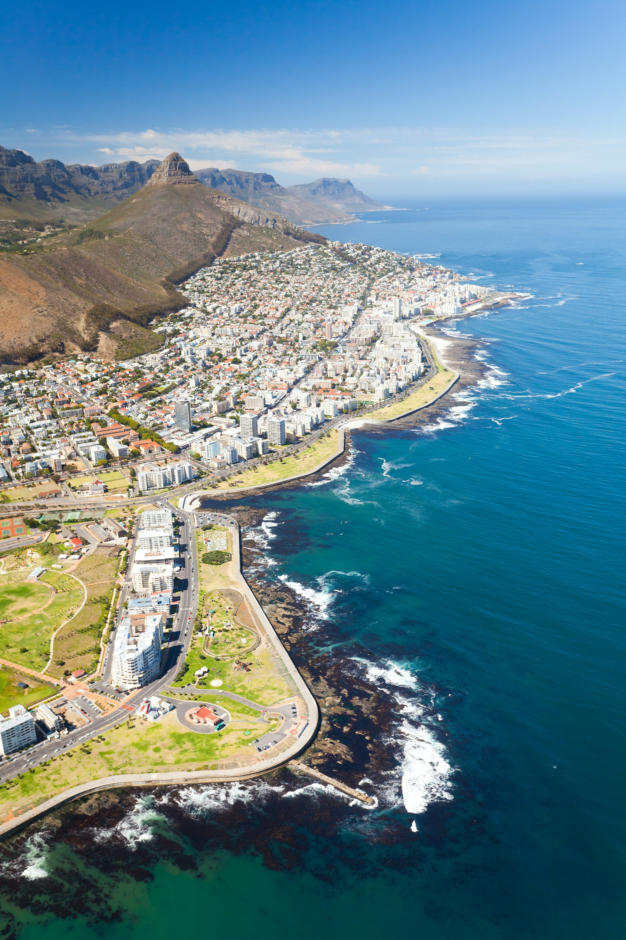 Aerial shot of the suburb of Sea Point under Lion's Head hill