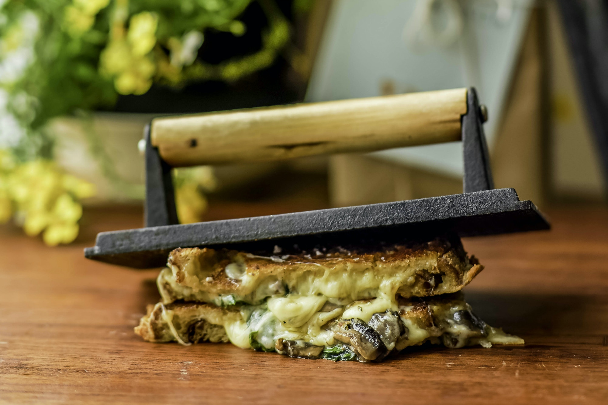 The Fonz Toastie beneath a cast-iron toastie maker