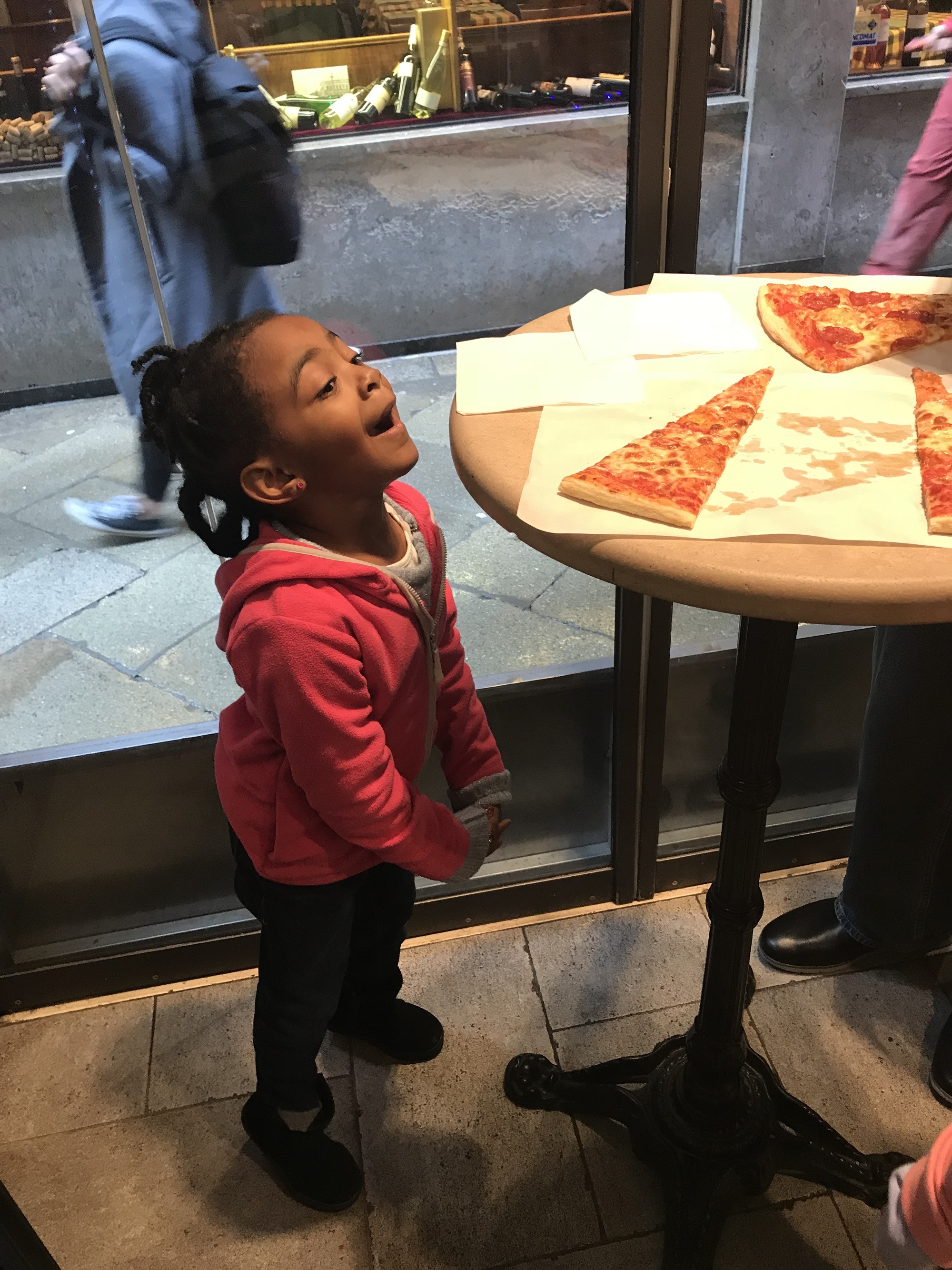 One of the Spring Break Family brood eyeing up some pizza on a table © the Spring Break Family