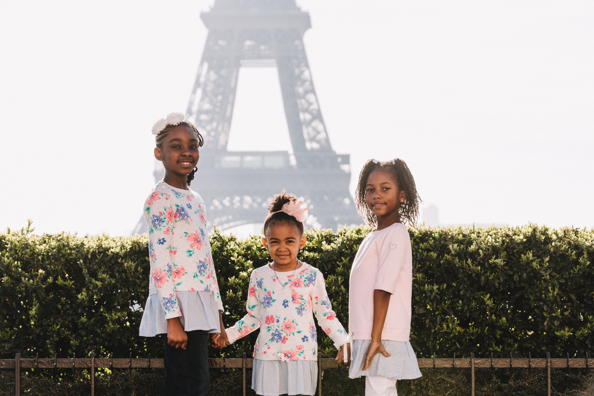 The Spring Break Family's three children in front of the Eiffel Tower, Paris, France © the Spring Break Family