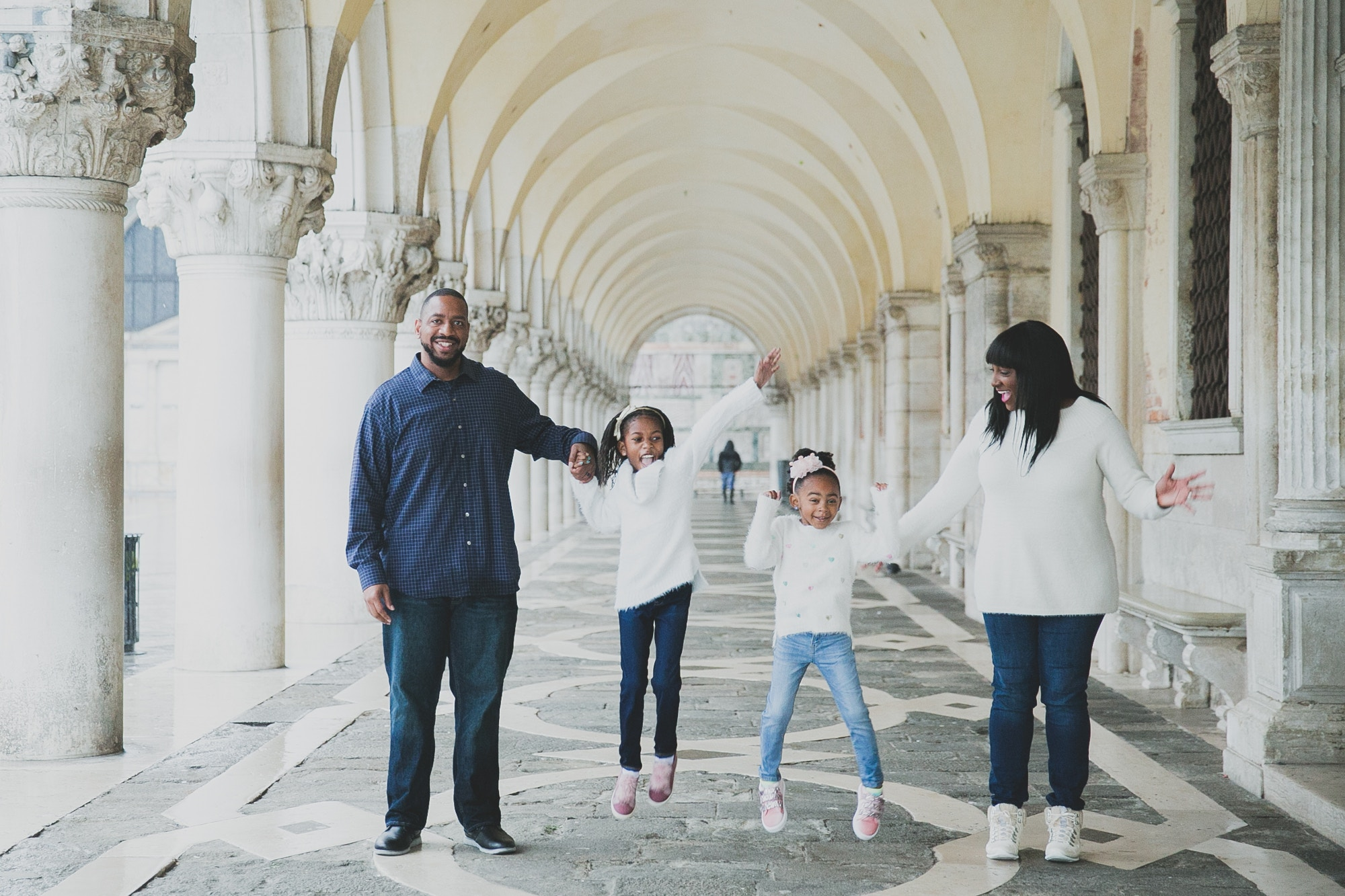 The Spring Break Family posing under some arches © the Spring Break Family