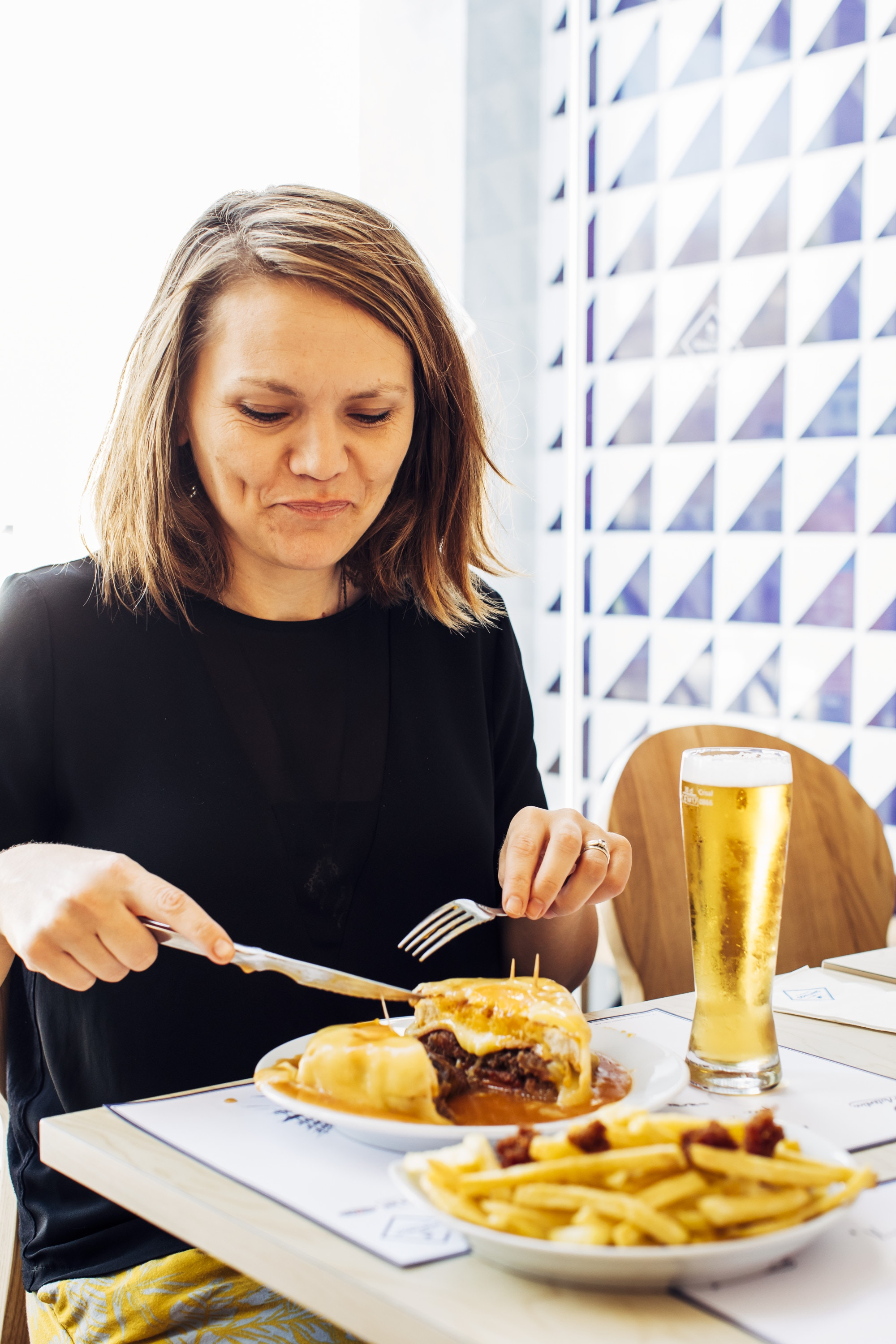 Orla tucking in to a traditional francesinha
